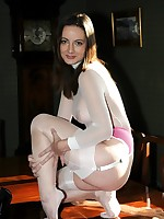 encased brunette stuffs nylons and heels