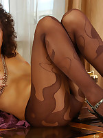 Upskirt teaser tugs at a waistband and licks her dark brown patterned hose